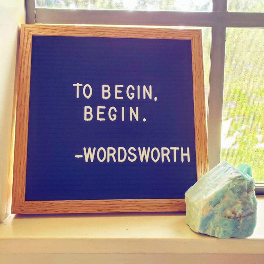 """A felt board saying """"To begin, begin."""""""